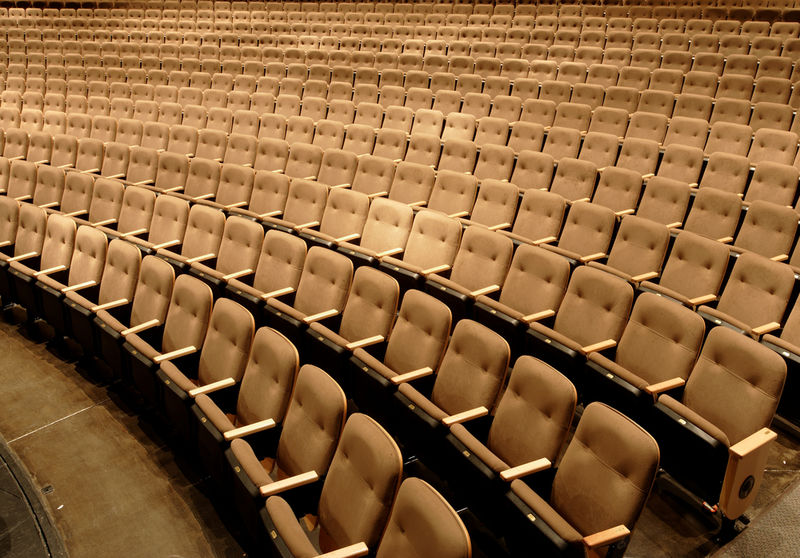 Auditorium empty chairs